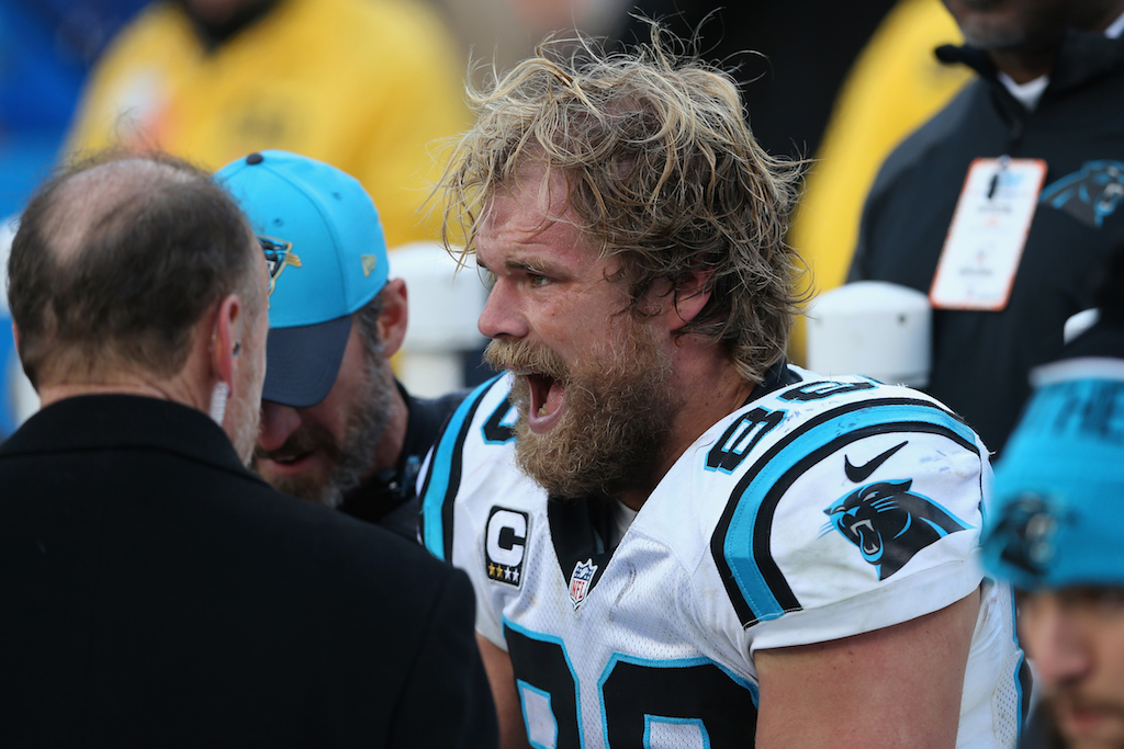 Greg Olsen gets checked out after being injured