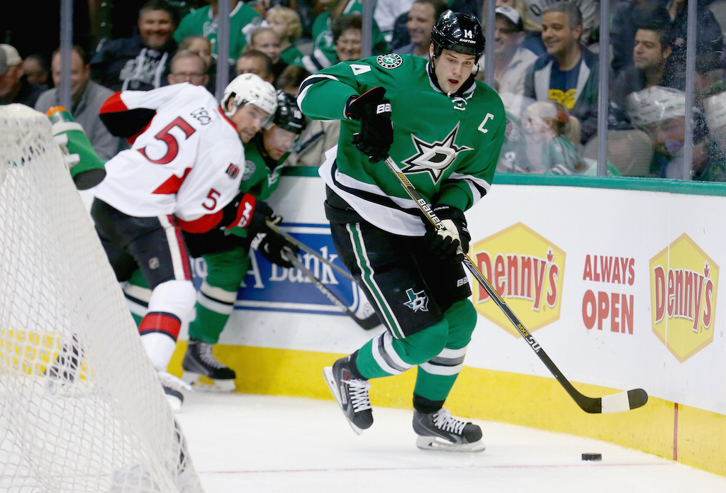 Jamie Benn #14 of the Dallas Stars controls the puck