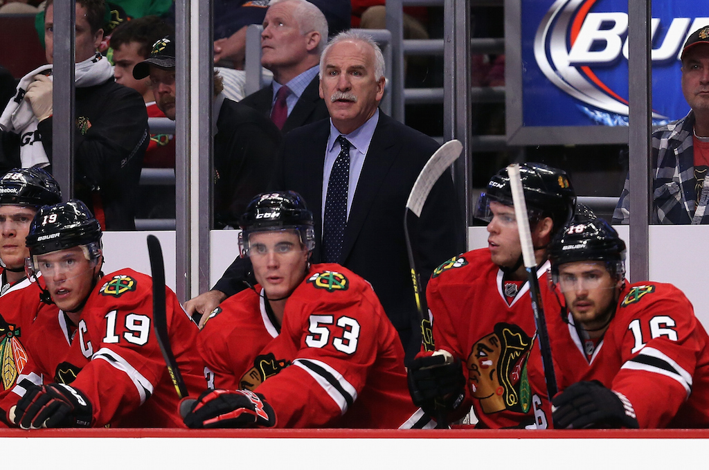 Joel Quenneville coaches the Blackhawks against the Canadiens