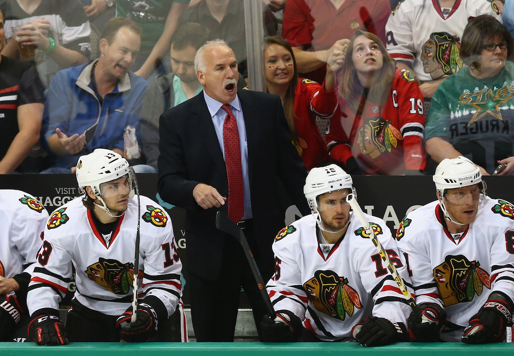 Joel Quenneville coaches Chicago against Dallas