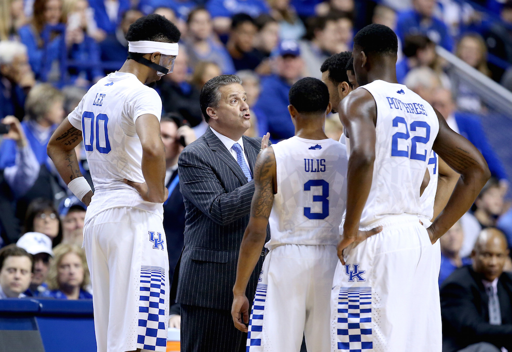 John Calipari the head coach of the Kentucky Wildcats gives instructions to his team against the Mississippi Rebels