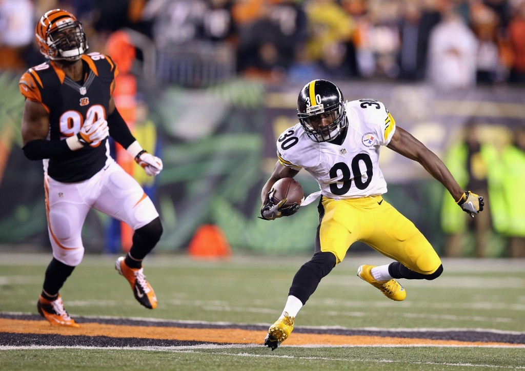Jordan Todman # 30 of the Pittsburgh Steelers chased by another player
