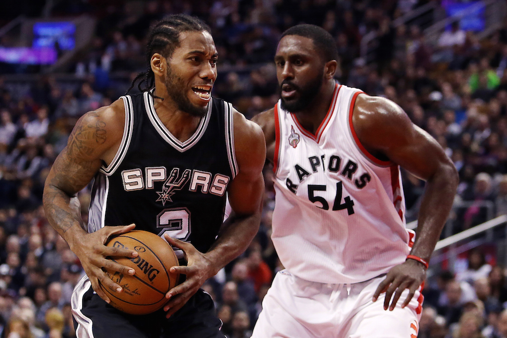 Kawhi Leonard #2 of the San Antonio Spurs battles with Patrick Patterson #54 of the Toronto Raptors