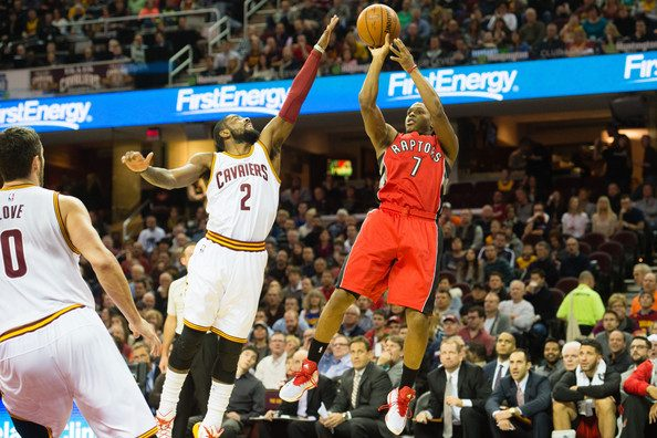 Kyrie Irving attempts to block Kyle Lowry's shot.