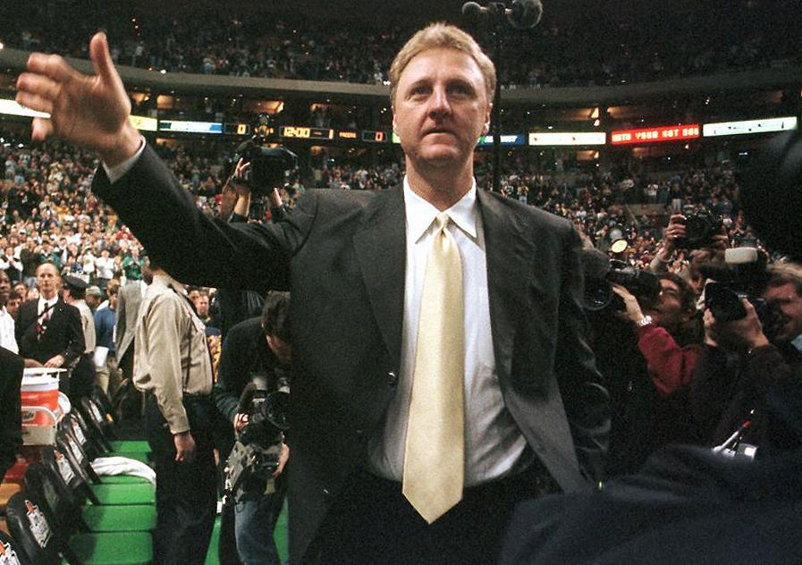 Larry Bird waves to the crowd.