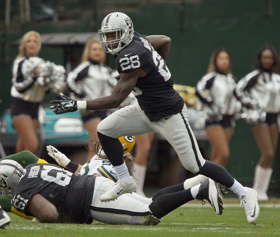 Running back Latavius Murray #28 of the Oakland Raiders gets a series of carries against the Green Bay Packers