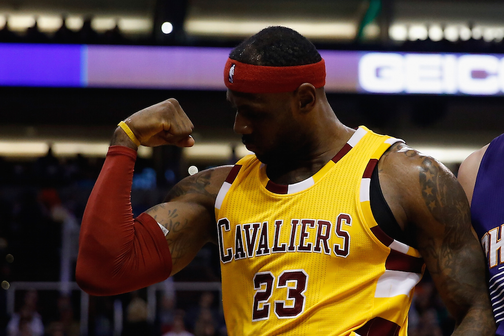 LeBron James flexes his muscles