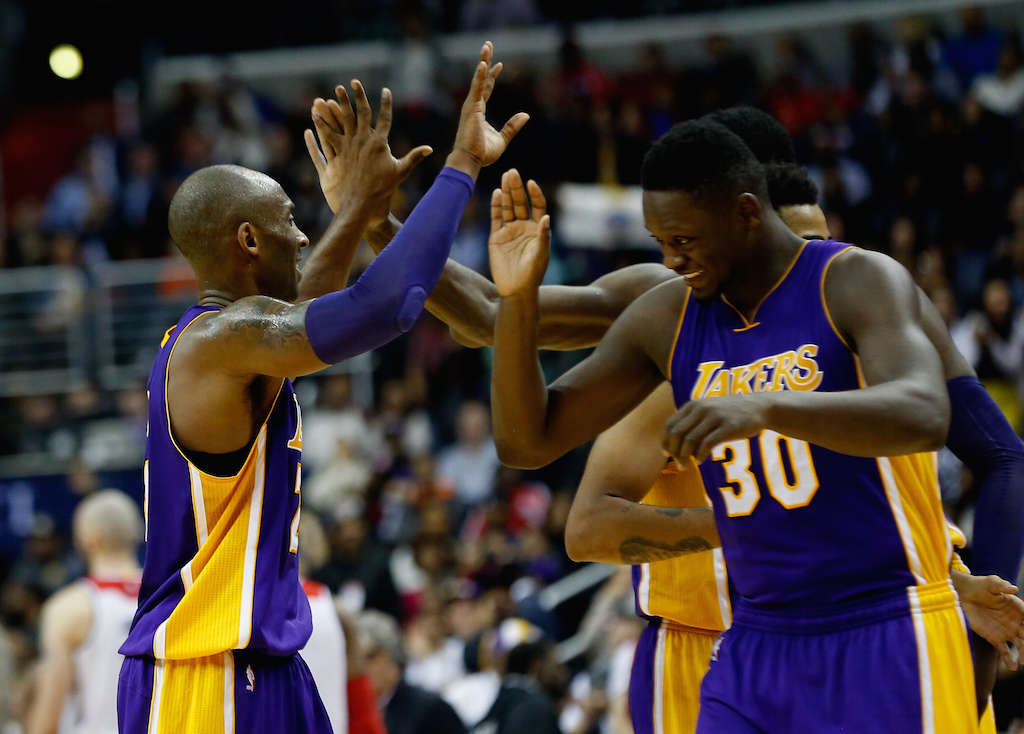 Kobe Bryant #24 of the Los Angeles Lakers celebrates with Julius Randle #30 during a timeout