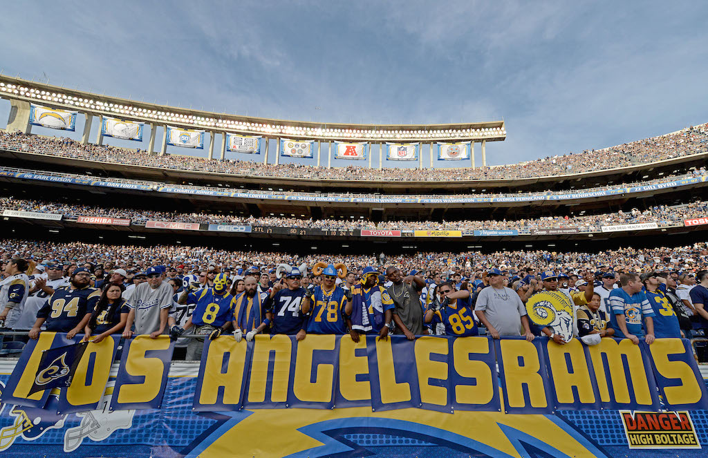 """Fans hold up """"Los Angeles Rams"""" sign"""
