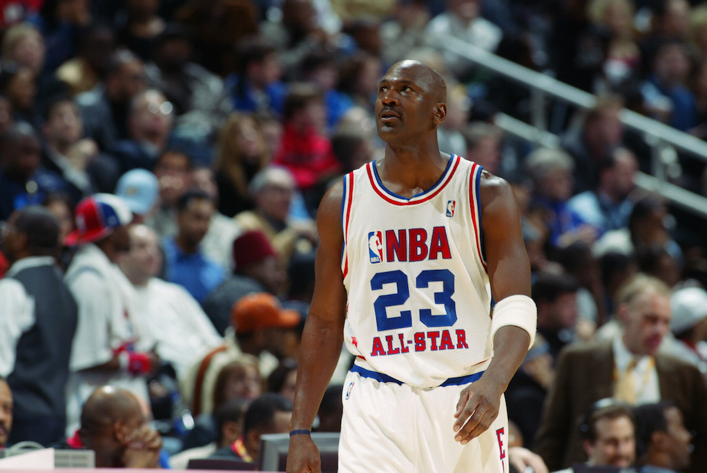 Michael Jordan walks along the court during an All-Star game.