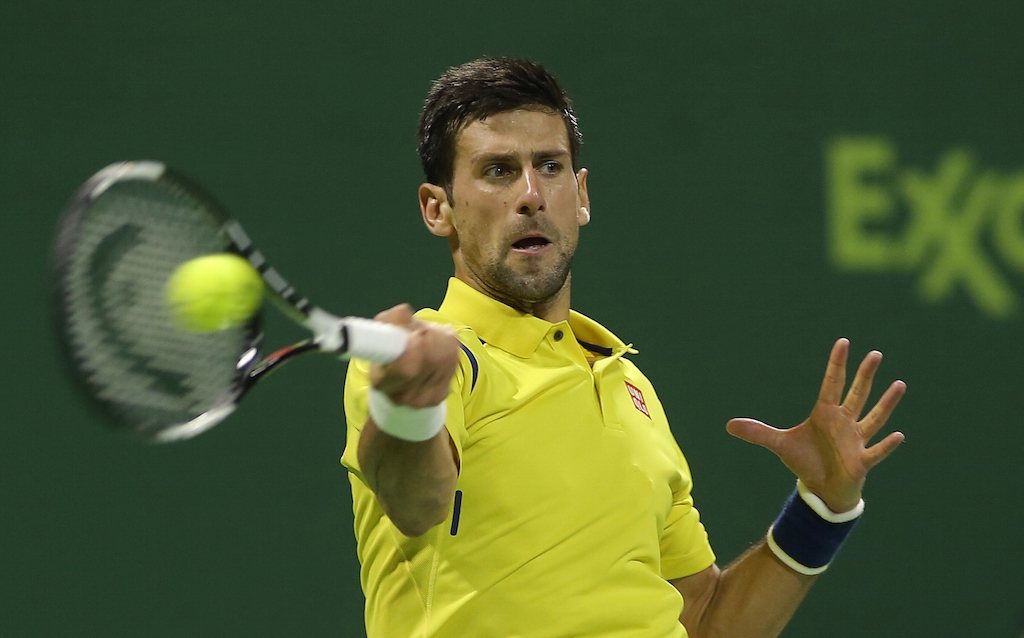 Novak Djokovic returns a shot with his forehand
