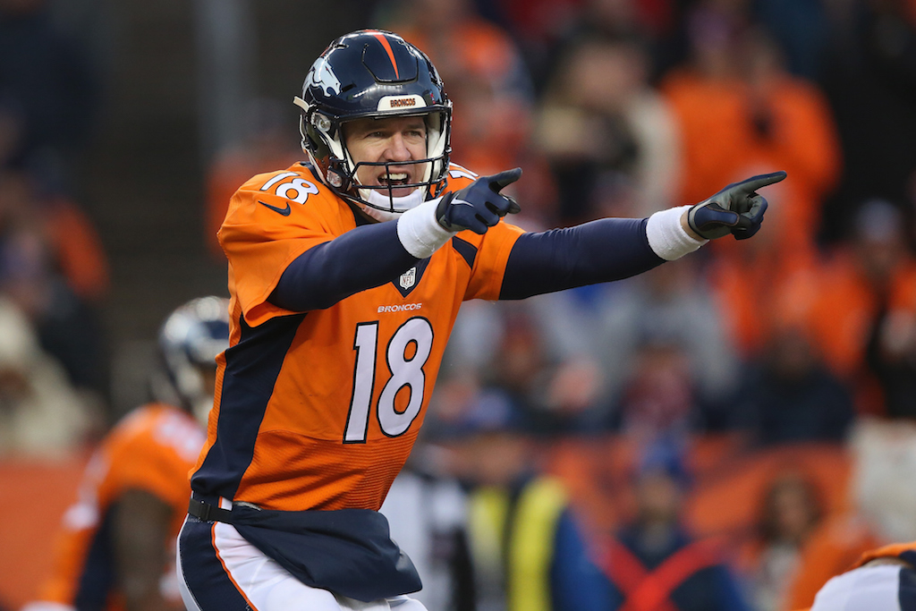 DENVER, CO - JANUARY 03: Quarterback Peyton Manning #18 of the Denver Broncos runs the offense against the San Diego Chargers at Sports Authority Field at Mile High on January 3, 2016 in Denver, Colorado.