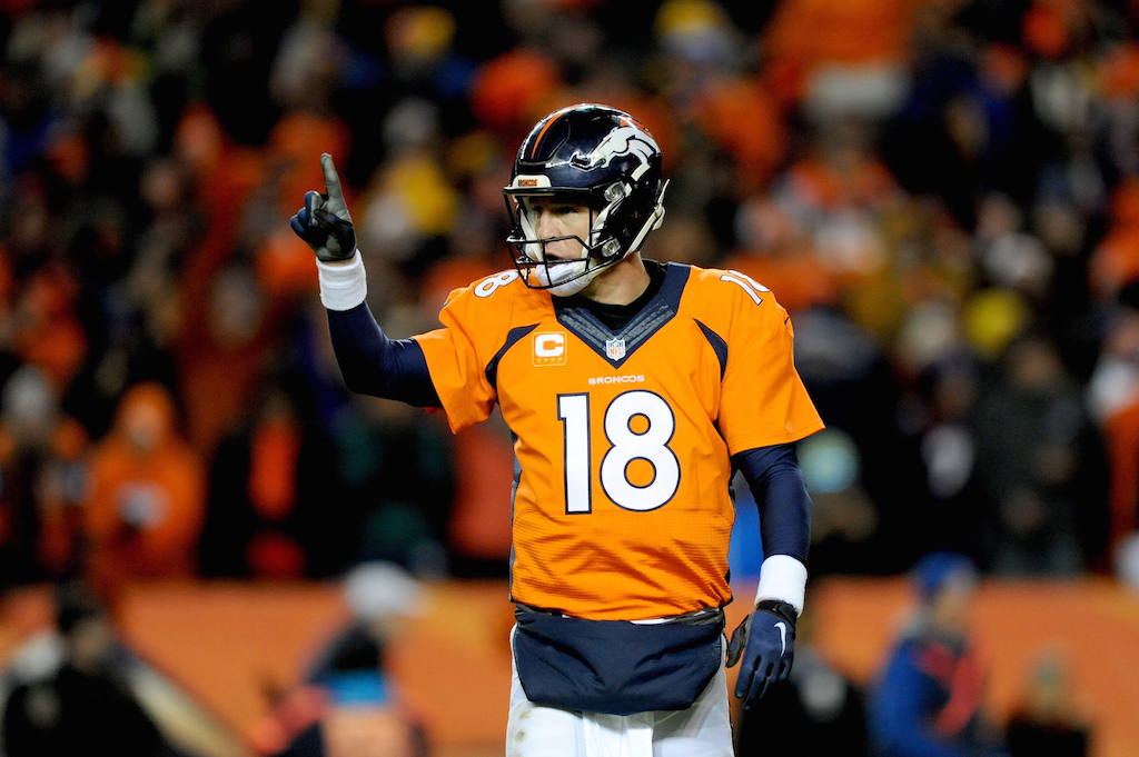 Peyton Manning points at his teammates before a play.