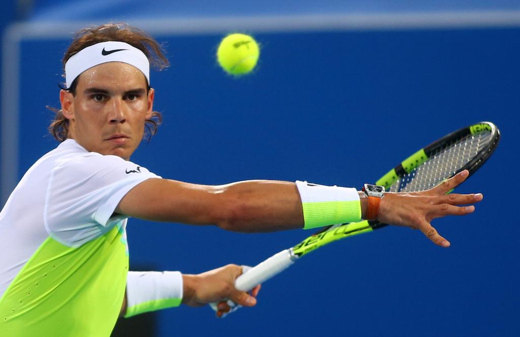 Rafael Nadal returns the ball