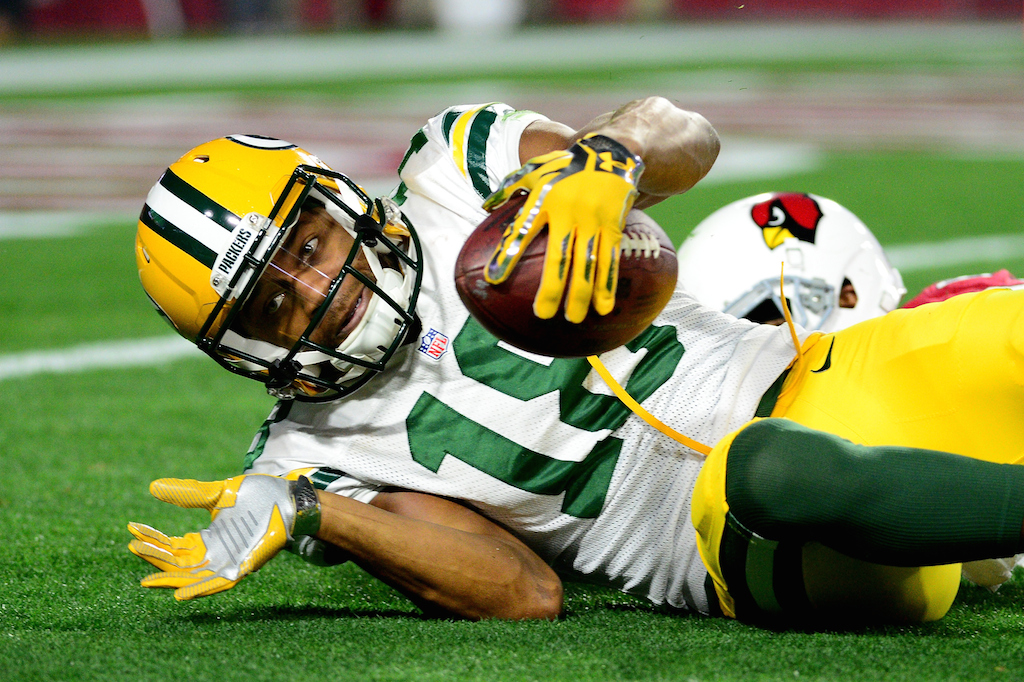 Randall Cobb makes a catch against the Cardinals