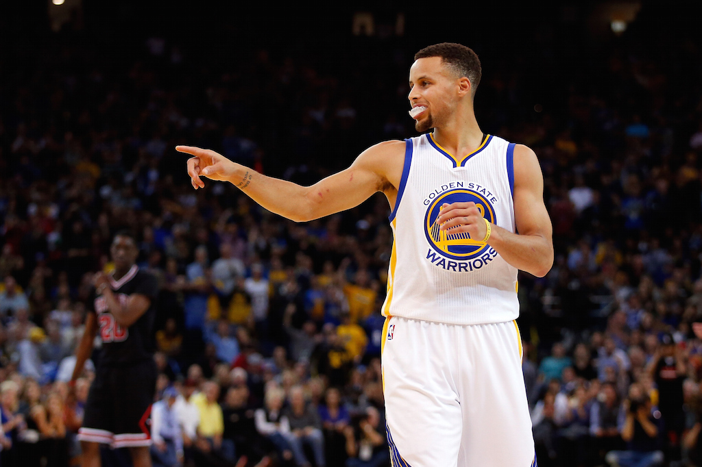 Stephen Curry #30 of the Golden State Warriors points to his teammates