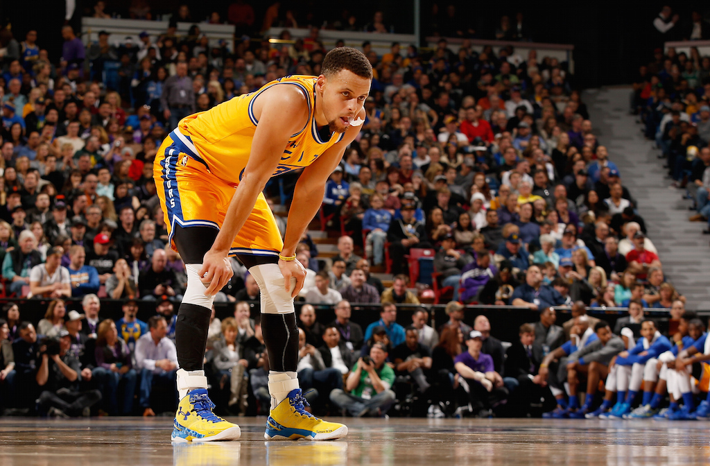 Stephen Curry rests during a game against the Kings