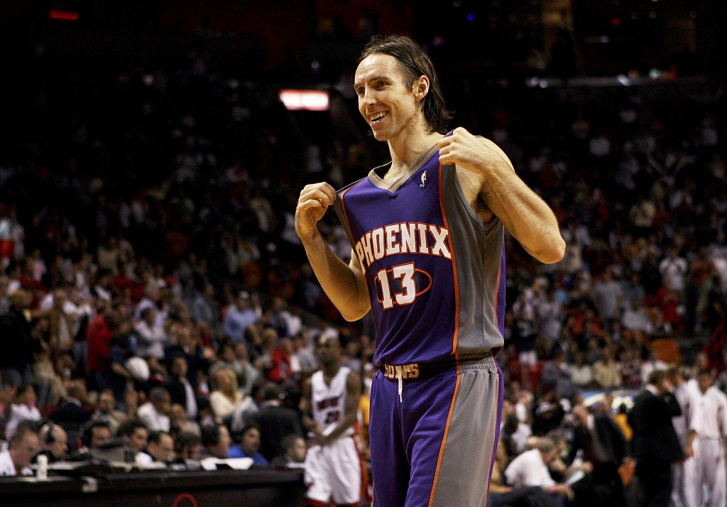 MIAMI - JANUARY 26: Steve Nash #13 of the Phoenix Suns walks off the court during a stoppage in play in the second half against the Miami Heat at American Airlines Arena on January 26, 2006 in Miami, Florida. The Suns defeated the Heat 107-98