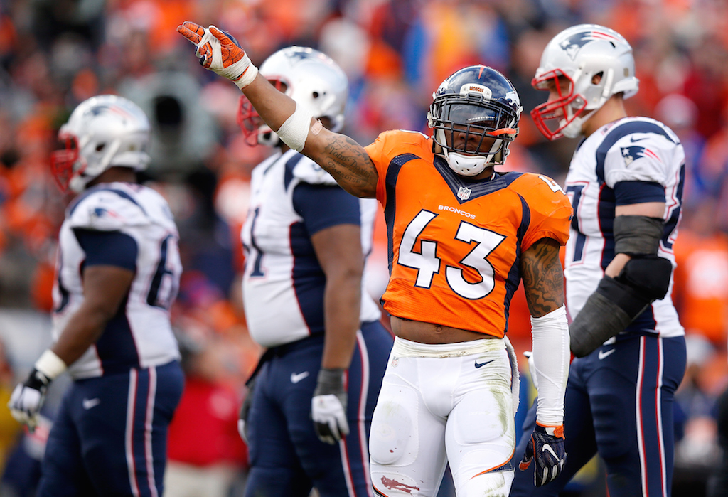 T.J. Ward #43 of the Denver Broncos gestures after a play in the first half against the New England Patriots in the AFC Championship game