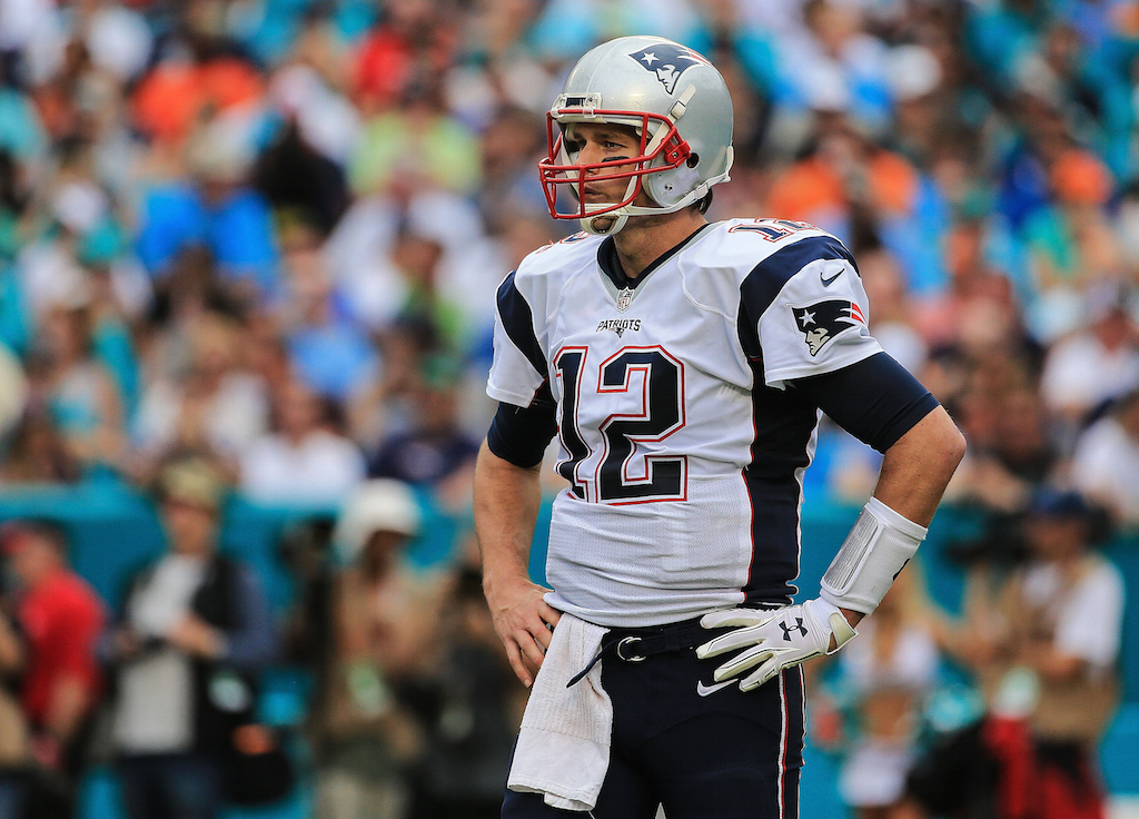 Tom Brady looks on during a game against the Dolphins