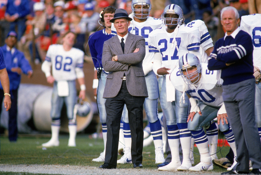 Tom Landry watches the game from the sidelines