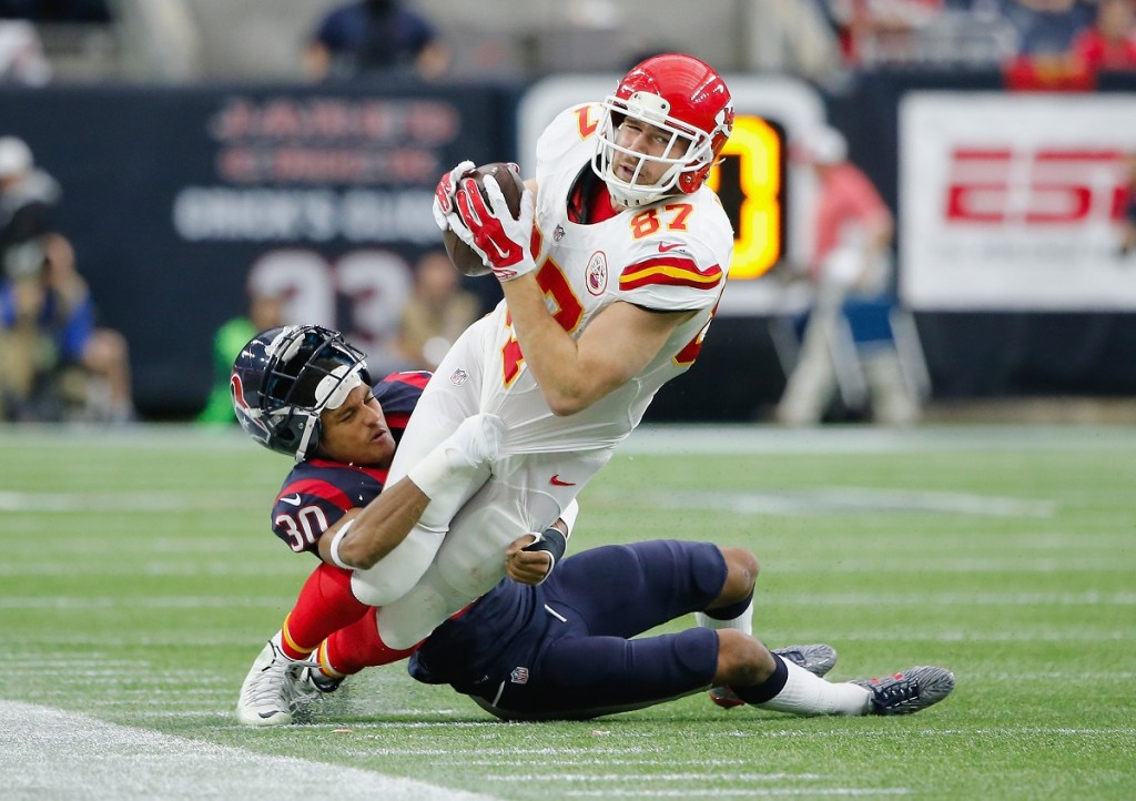 Travis Kelce # 87 of the Kansas City Chiefs tackled by Kevin Johnson
