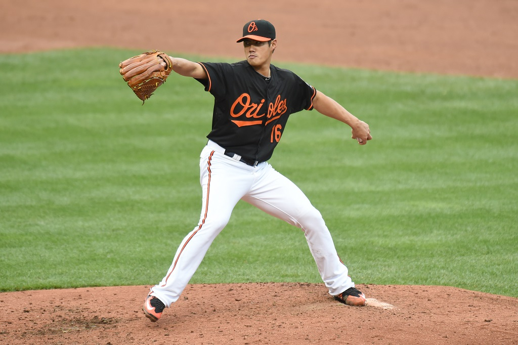 BALTIMORE, MD - OCTOBER 03:  Wei-Yin Chen #16 of the Baltimore Orioles pitches in the sixth inning during game one of a baseball game against the New York Yankees at Oriole Park at Camden Yards on October 3, 2015 in Baltimore, Maryland.  The Orioles won 9-2.