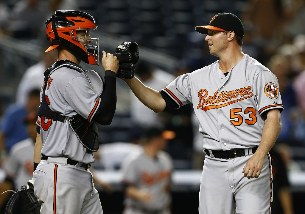 NEW YORK, NY - SEPTEMBER 09: Catcher Caleb Joseph #36 congratulates closer Zach Britton #53 of the Baltimore Orioles after defeating the New York Yankees 5-3 in a MLB baseball game at Yankee Stadium on September 9, 2015 in the Bronx borough of New York City.