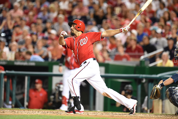 Anthony Rendon watches the ball fly out of the stadium after he makes contact.