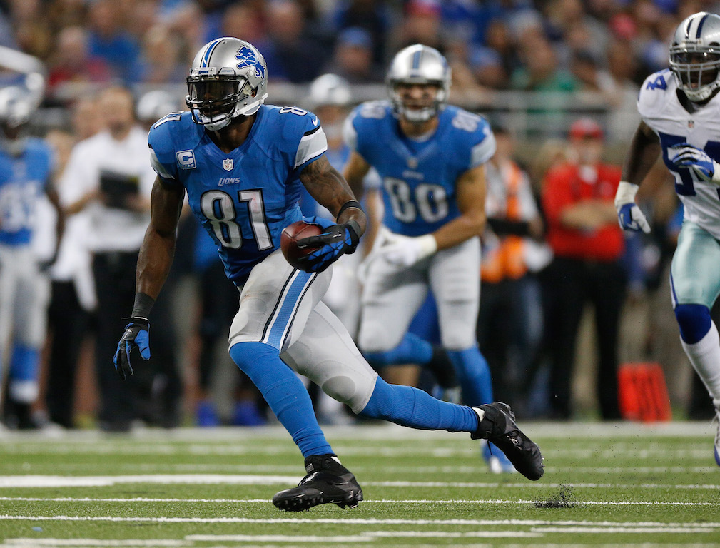 Calvin Johnson #81 of the Detroit Lions runs for extra yards after a third quarter catch while playing the Dallas Cowboys