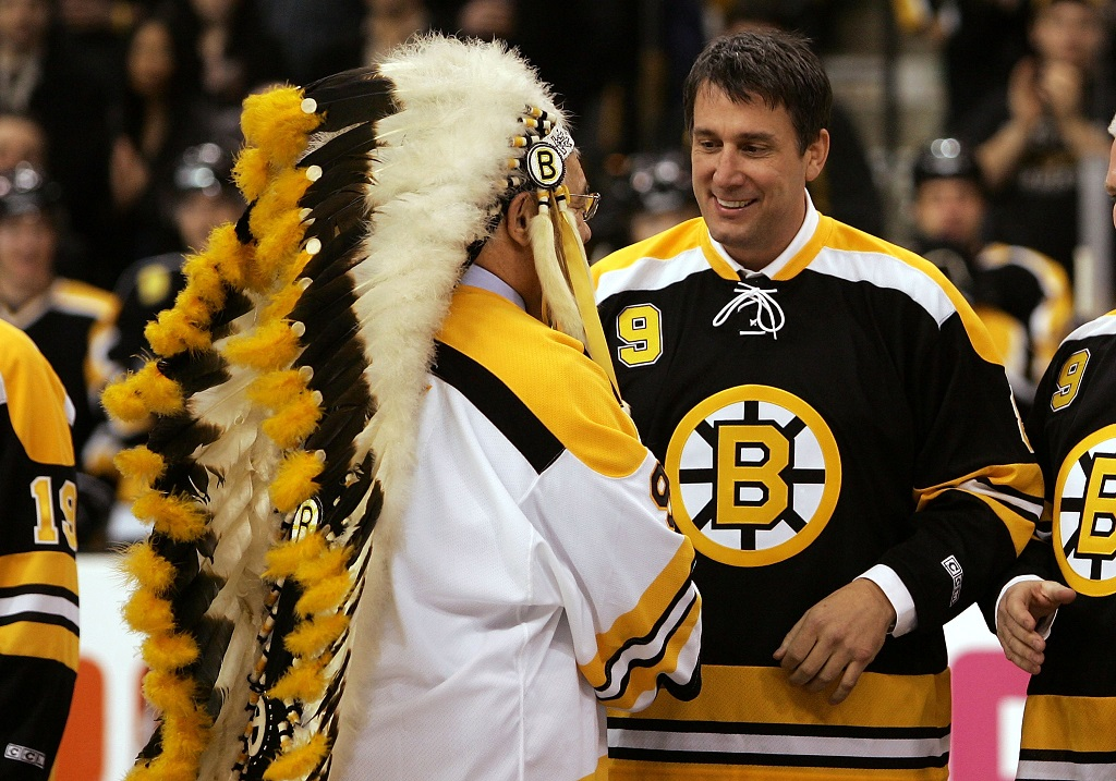 "BOSTON - FEBRUARY 13:  Former Bruin player John ""the Chief"" Bucyk shakes hands with Cam Neely as Bucyk was honored for his fifty years with the Boston Bruins organization before the game between the Edmonton Oilers and the Boston Bruins on February 13, 2007 at the TD Banknorth Garden in Boston, Massachusetts.  (Photo by Elsa/Getty Images)"