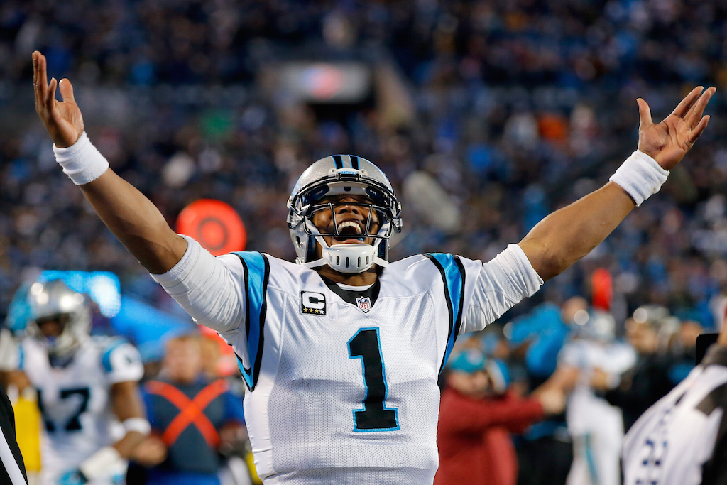 Cam Newton celebrates a touchdown during the NFC Championship Game