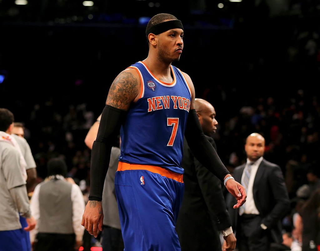 Carmelo Anthony walking on the court during a game.