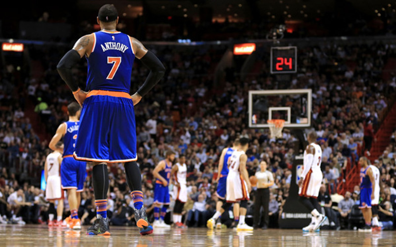 Carmelo Anthony stands on the court between plays.