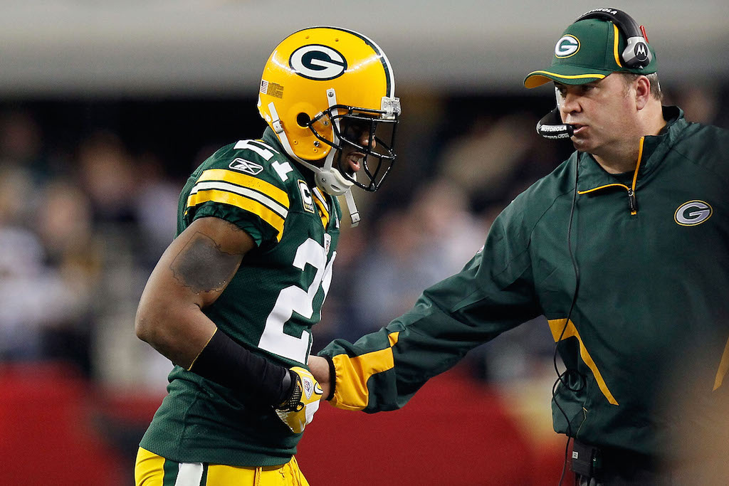 Charles Woodson #21 of the Green Bay Packers walks off the field after being injured during Super Bowl XLV