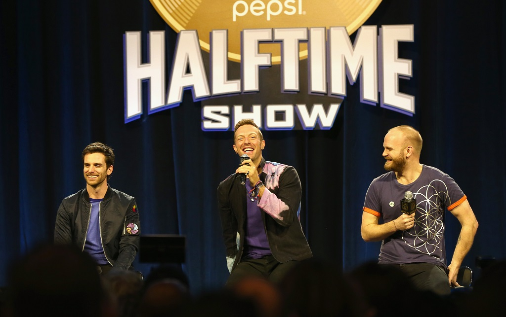 Coldplay speaks onstage at the Pepsi Super Bowl Halftime Press Conference.