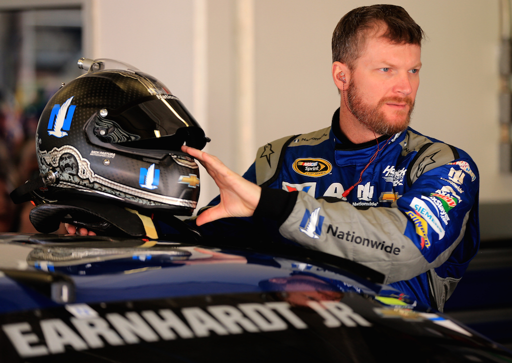 Dale Earnhardt Jr. stands in the garage area during practice for the NASCAR Sprint Cup Series Daytona 500