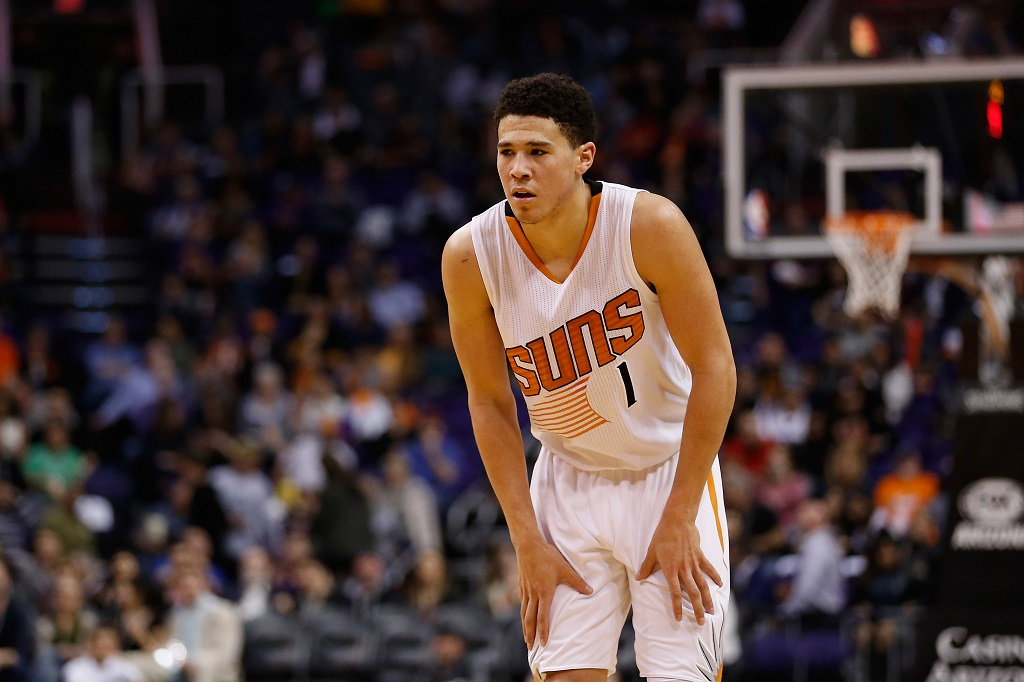 Devin Booker looks on during the second half of an NBA game.