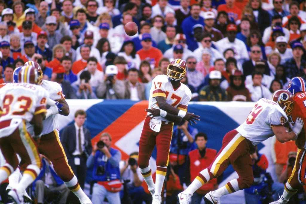 SAN DIEGO - JANUARY 31: Quarterback Doug Williams #17 of the Washington Redskins passes during Super Bowl XXII against the Denver Broncos at Jack Murphy Stadium on January 31, 1988 in San Diego, California. The Redskins won 42-10. (Photo by Stephen Dunn/Getty Images)