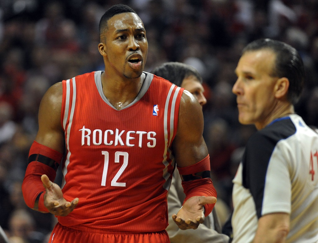 PORTLAND, OR - APRIL  27: Dwight Howard #12 of the Houston Rockets argues a call with referee Ken Mauer #41 in the first quarter of Game Four of the Western Conference Quarterfinals against the Portland Trail Blazers during the 2014 NBA Playoffs at the Moda Center on April 27, 2014 in Portland, Oregon.