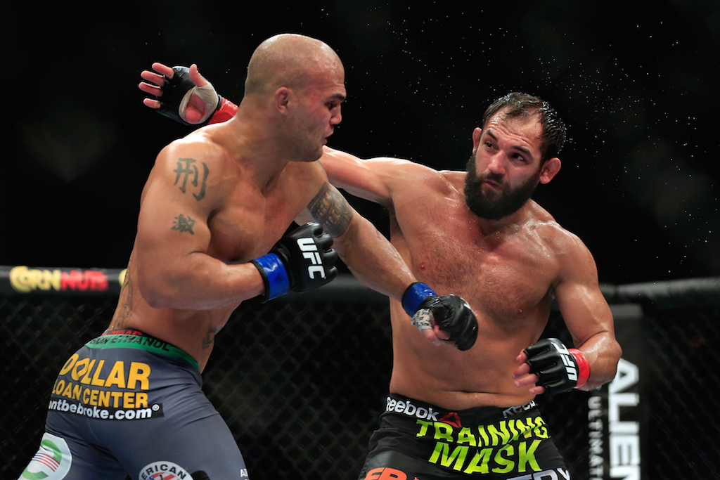 Robbie Lawler punches Johny Hendricks at UFC 181 (Photo by Alex Trautwig/Getty Images)