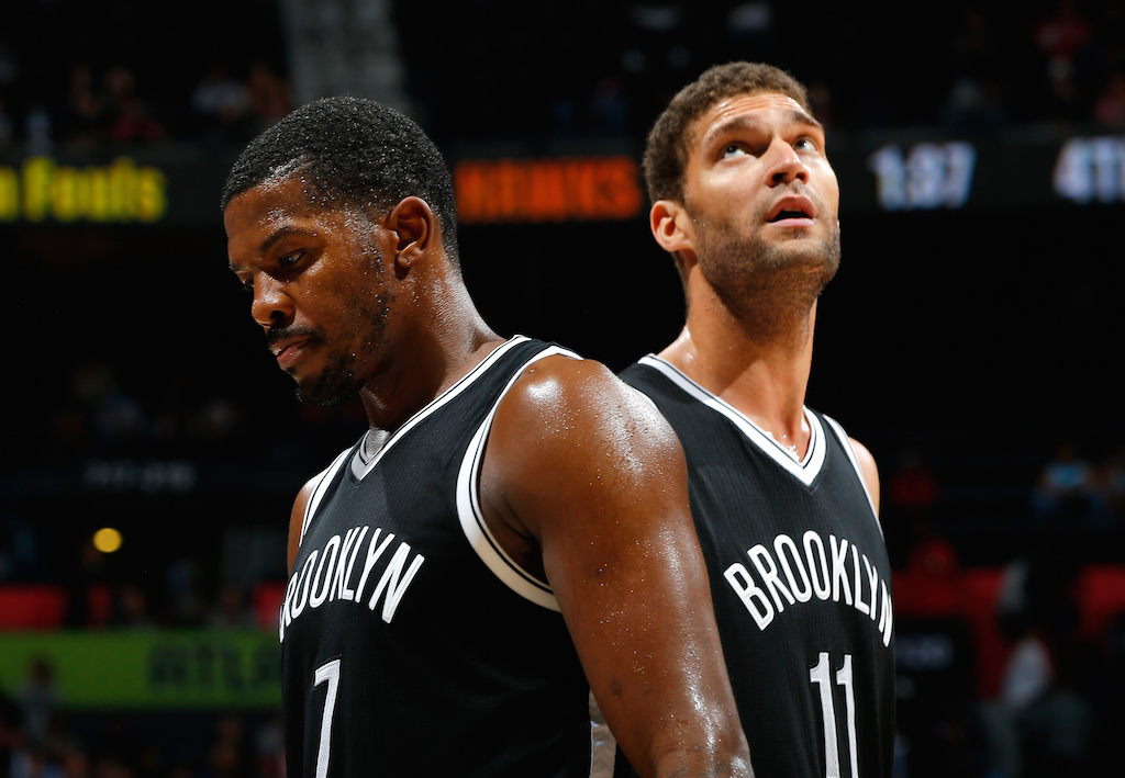 Brooklyn Nets teammates look dejected.