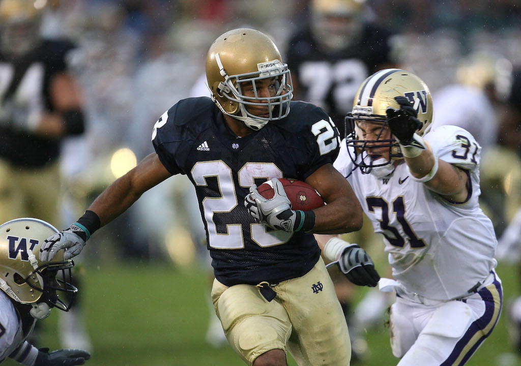 Golden Tate runs after the catch
