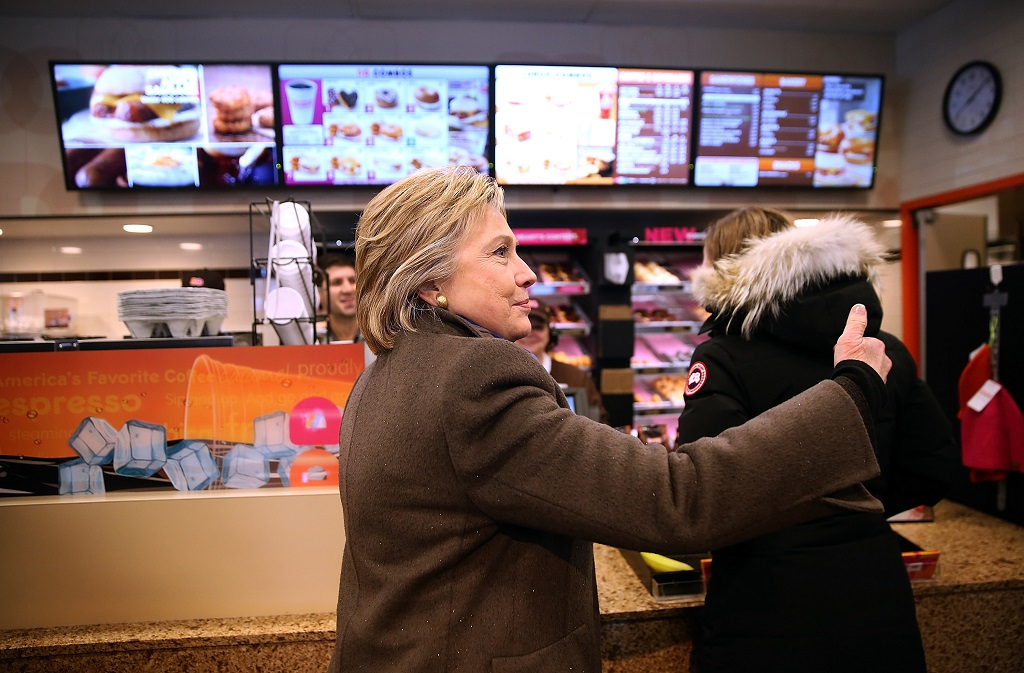 Hillary Clinton in a Dunkin' Donuts, a New England staple.