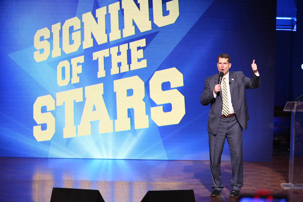 Rey Del Rio/Getty ImagesHead coach Jim Harbaugh of the Michigan Wolverines speaks during the Michigan Signing of the Stars event