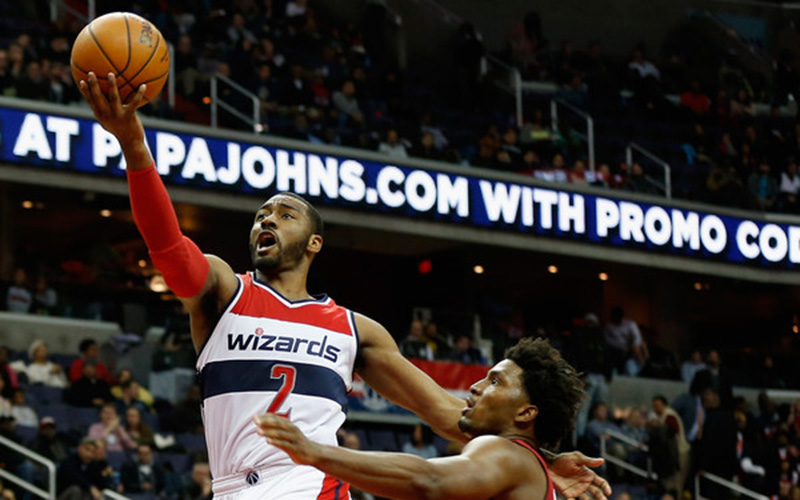 John Wall drives to the basket for a layup.