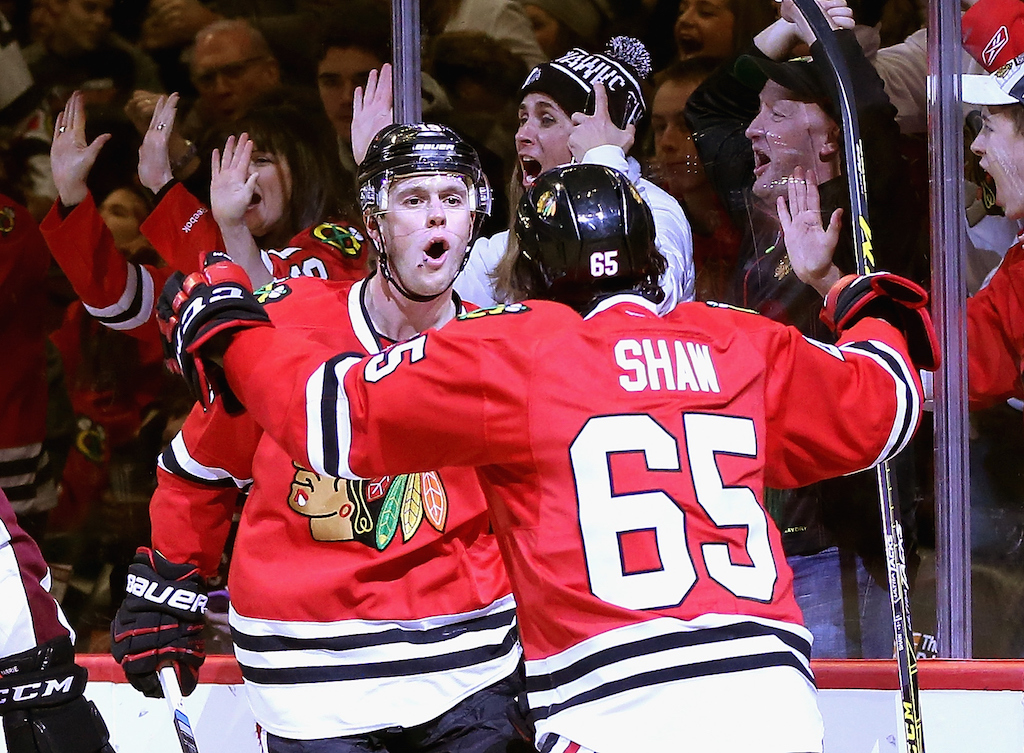 Jonathan Toews #19 of the Chicago Blackhawks celebrates his second period goal with teammate Andrew Shaw #65