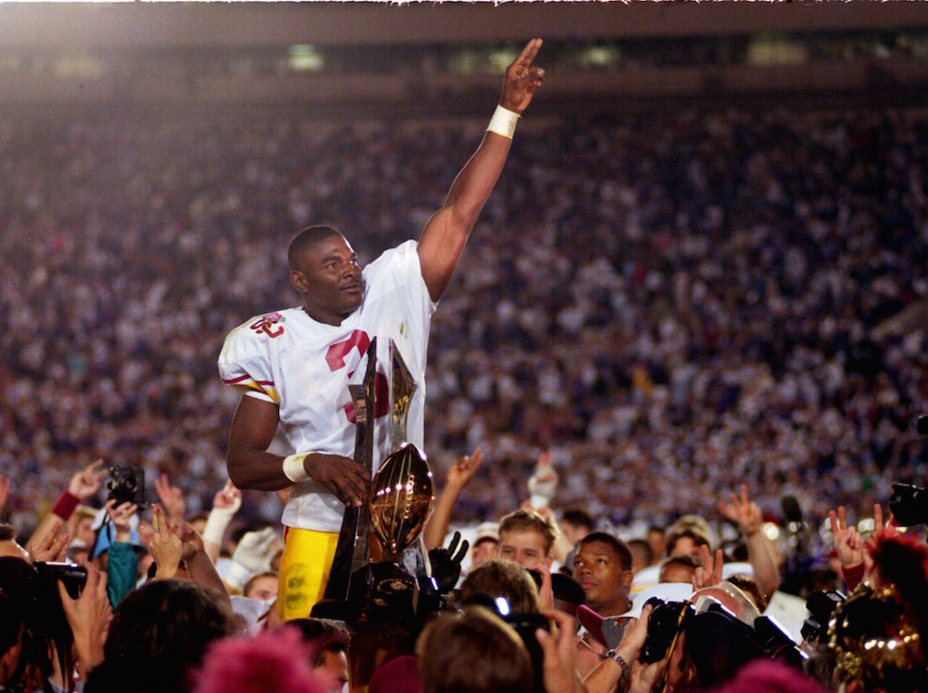 WIDE RECEIVER KEYSHAWN JOHNSON OF USC #3 HOLDS ONTO THE ROSE BOWL TROPHY