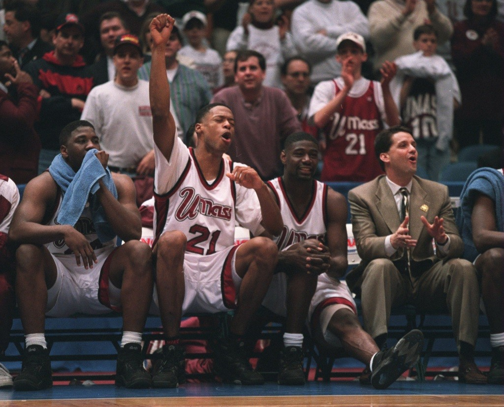 24 MAR 1995: MARCUS CAMBY, #21 OF UMASS CELEBRATES THE WIN OVER TULSA IN THE SEMI-FINAL GAME AT THE NCAA EAST REGIONALS AT THE BRENDAN BYRNE ARENA IN THE MEADOWLANDS,NEW JERSEY. Mandatory Credit: Rick Stewart/ALLSPORT