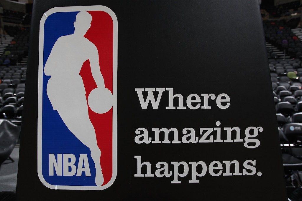 A basketball court shows off an NBA logo.